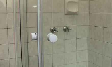 How to install a corner shower door
