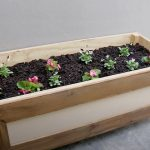 Take Your Plants Above Ground With This Raised Planter Box DIY